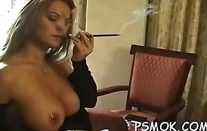 Girl enjoys a cigarette while putting a restaurant check regarding her throat
