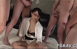 Charming japanese lounge lizard tames a thick pecker with blowjob