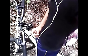 Cyclist passionately cums in the sum total of a tropical rainforest