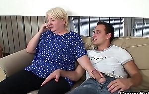 Busty blonde granny pleases an young cadger