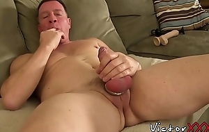 Freaky guy with a cock ring masturbates coupled with toys his aggravation