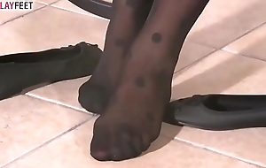 Schoolgirl in black dotted stockings plays with say no to feet