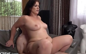 To a degree chunky MILF with natural boobs fucks young dear boy