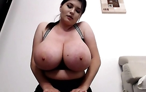 Curvaceous brunette flashes her massive boobs on cam